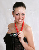 Soap bubbles, Closeup portrait of a happy young brunette woman Stock Photo