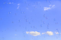 Soap bubbles floating in a blue sky Royalty Free Stock Photos