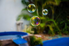 Soap bubbles fly in the swimming pool.  Stock Photo