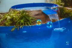 Soap bubbles fly in the swimming pool.  Stock Photography