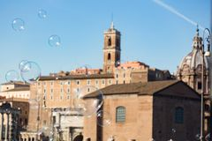 Soap bubbles flying in front of the cityscape of rome italy on s royalty free stock photos