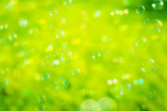 Soap bubbles with green background. Soap bubbles outside with green background Stock Photos