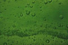 Soap bubbles green liquid background Stock Photos