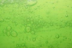 Soap bubbles green liquid background Stock Photo