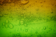 Soap bubbles green liquid background Royalty Free Stock Photo