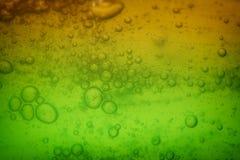 Soap bubbles green liquid background Royalty Free Stock Photo