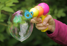 Soap bubbles gun Royalty Free Stock Photography