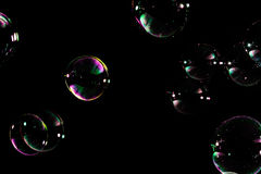Soap bubbles isolated. On black background Stock Photo