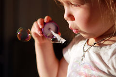 Soap bubbles. Little cheerful inflates soap bubbles Stock Images
