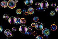 Soap bubbles. Many colorful soap bubbles on black background Stock Photos