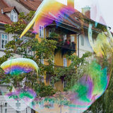 Soap bubbles and old houses Stock Image
