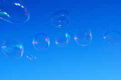 Soap bubbles over blue sky Royalty Free Stock Photos