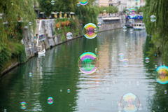 Soap bubbles over Ljubljanica. River Royalty Free Stock Photos