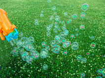 Soap bubbles over meadow Stock Photography