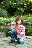 Soap bubbles at the pond Royalty Free Stock Photo