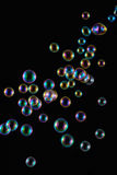 Soap Bubbles with Rainbow Reflection Stock Photo