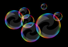 Soap bubbles set against a black background clear curls Royalty Free Stock Images