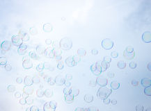 Soap bubbles on sky background. Colourful soap bubbles on blue sky background Royalty Free Stock Images