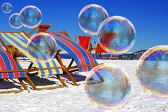 Soap bubbles on snow Royalty Free Stock Photos