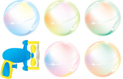 Soap Bubbles and squirt gun Stock Photography