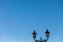 Soap bubbles and vintage street lamp Stock Photo