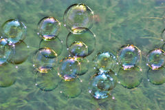 Soap bubbles on water stock photos