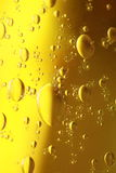Soap bubbles yellow liquid background Stock Photography