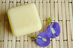 Soap and butterfly pea purple flower on bamboo mat Stock Photos