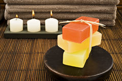 Soap candles and towels in a spa Stock Photo