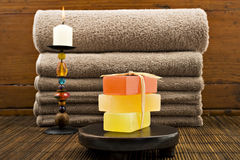 Soap candles and towels in a spa Stock Photos