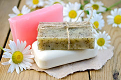 Soap with chamomile on a board Royalty Free Stock Images