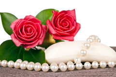 Soap decorated with red roses and pearls Stock Images