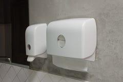 Soap Dispenser and Paper Dispenser. Liquid Soap Dispenser Pump and Paper Dispenser in public toilet stock photo