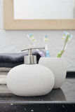 Soap dispenser with a toothbrushes Stock Images
