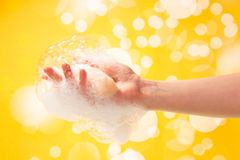 Soap in female hand. Piece of soap bar in female hand Stock Photos