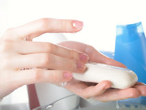 Soap and female hands Stock Photo