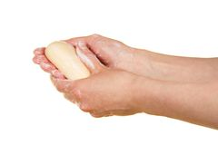 Soap in the female hands Royalty Free Stock Images