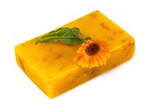 Soap with flower. Macro view of handmade soap with marigold isolated on white background Royalty Free Stock Photography