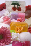 Soap and flower. Lot of various soap and pink flower Royalty Free Stock Image