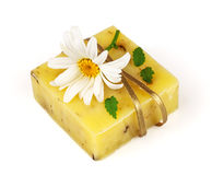 Soap with flower and ribbon. Macro view of handmade soap with camomile isolated on white background Stock Photo