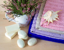 Soap, flower and towels Royalty Free Stock Photography