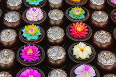 Soap flowers. Handmade carved from soap flowers in round boxes with metal incrustation, Thiland Royalty Free Stock Image