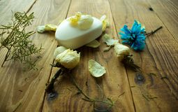 Soap and flowers on a wooden background royalty free stock photo