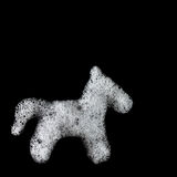 Soap foam horse silhouette. Suds, shower. Black background. soft focus, close-up, up view, copyspace, copytext Stock Images