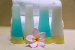 Soap and frangipani. Soap and orchid with amenities and towels Royalty Free Stock Photo