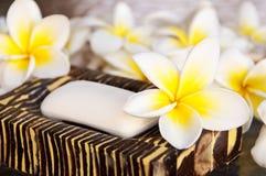 Soap and frangipani flowers. (plumeria Stock Images