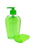 Soap green liquid and solid. Green liquid soap in a bottle, a green piece of solid soap with a light shade on white background Royalty Free Stock Images