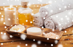 Soap, himalayan salt, scrub in bowl, towel and oil Royalty Free Stock Photo