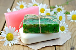 Soap homemade with chamomile on a board Stock Photography