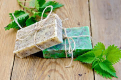Soap homemade with nettle on the board Stock Photos